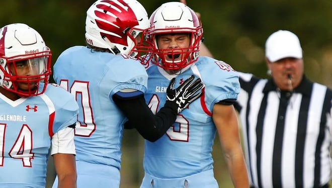 From left, Glendale defensive players Nick Austin and Carson Liston celebrate a stop during the Falcons game against West Plains a Lowe Stadium Friday, Sept. 2, 2016.