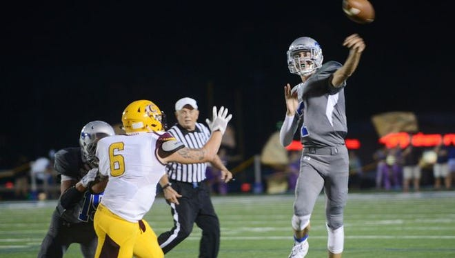 Smoky Mountain's Cole Hooper throws a pass during last Thursday's home win over Cherokee.