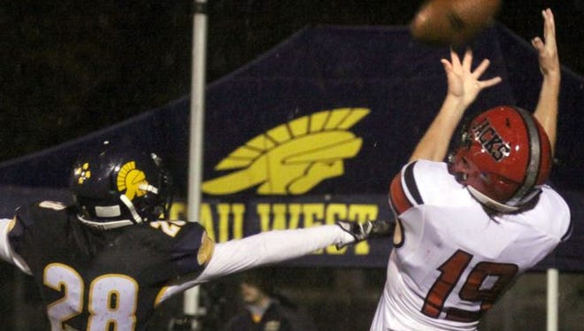 Wausau East's Wyatt Rottier goes up for a pass during the Log Game matchup with Wausau West last fall. The Lumberjacks played an independent schedule last season after leaving the Valley Football Association.