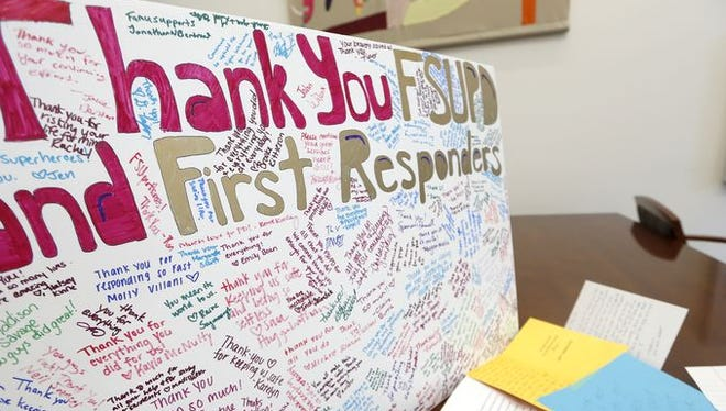A sign created by FSU students thanking first responders for their response to the Strozier Library shooting.