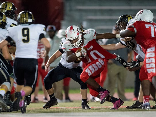 Bosse's Zy'Keith Davis (10) gets his jersey tugged