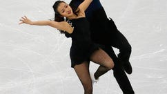 In this Feb. 16, 2017, photo,  Yura Min and Alexander Gamelin perform in the Ice Dance Short Dance program at the ISU Four Continents Figure Skating Championships in Gangneung, South Korea. Gamelin, an ice dancer from Boston, has the anthem memorized and is brushing up on Korean culture and history ahead of his immigration interview. The aim is to become a naturalized citizen, then a South Korean Olympian. Gamelin's dance partner, California-born South Korean citizen Yura Min.  (AP Photo/Ahn Young-joon)