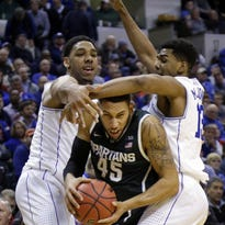 Michigan State's Denzel Valentine is trapped by Duke's Jahlil Okafor, left, and Matt Jones during the during their Nov. 18 game in Indianapolis, won by Duke, 81-71.