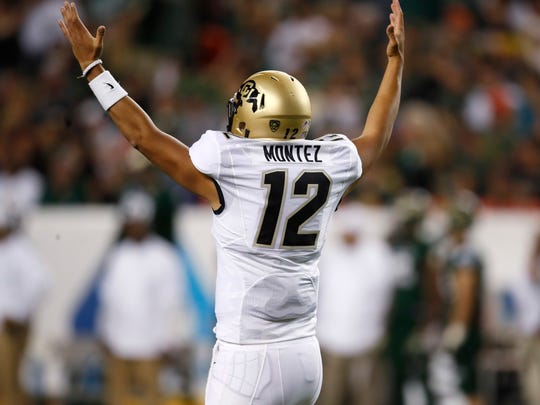 Colorado quarterback Steven Montez celebrates after completing a pass to wide receiver Laviska Shenault Jr. for an 89-yard touchdown during the second half of an NCAA college football game against Colorado State on Friday, Aug. 31, 2018, in Denver. Colorado won 45-13. (AP Photo/David Zalubowski)