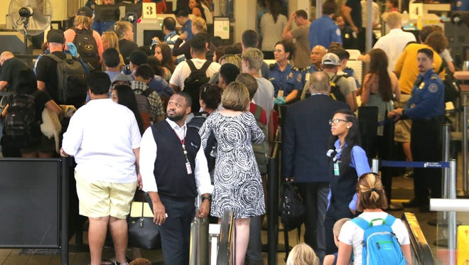 Passengers proceed through Transportation Security Administration checkpoint at Terminal 3 at Los Angeles Airport in Los Angeles, California, on July 1, 2016.