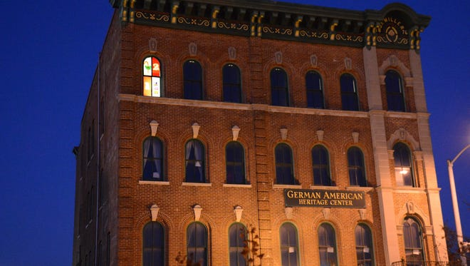 The first window of the German American Heritage Center in Davenport lit up on Dec. 1.