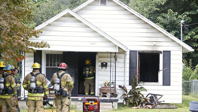 Firefighters respond to the scene of a Springfield house fire in August.