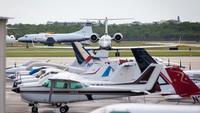 Planes sit parked on the apron at the Naples Municipal Airport on Thursday, Oct. 6, 2016. Airport authorities say they have seen an increase in traffic since Tuesday because of planes being brought to Naples as refuge from Hurricane Matthew.