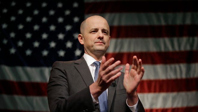 """This Nov. 8, 2016, file photo, conservative presidential candidate Evan McMullin speaks to his supporters during an election night watch party after Republican Donald Trump won Utah, in Salt Lake City. McMullin has created a group that he says will expand his ability to serve as a watchdog over President Donald Trump. McMullin on Wednesday, Jan. 25, 2017, announced the launch of the """"Stand Up Republic"""" group."""