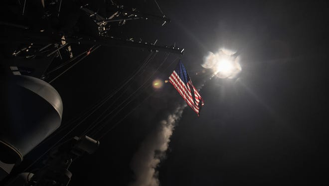 The guided-missile destroyer USS Porter fires a Tomahawk land attack missile April 7, 2017 in the Mediterranean Sea. The USS Porter was one of two destroyers that fired a total of 59 cruise missiles at a Syrian military airfield in retaliation for a chemical attack that killed scores of civilians this week.