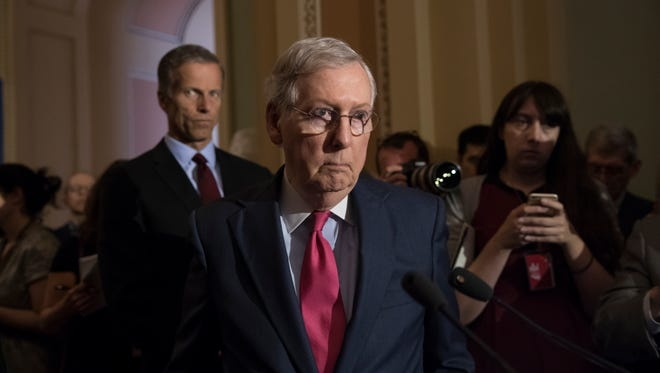 Senate Majority Leader Mitch McConnell of Ky., joined by Sen. John Thune, R-S.D., left, reacts to questions from reporters about President Donald Trump reportedly sharing classified information with two Russian diplomats during a meeting in the Oval Office, Tuesday, May 16, 2017, on Capitol Hill in Washington.