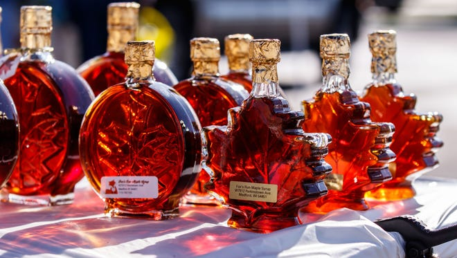 Locally produced maple syrup glistens in the morning sun at the market. Both the numbers of maple tree taps and gallons of maple syrup produced in Wisconsin this spring were down compared to 2016,