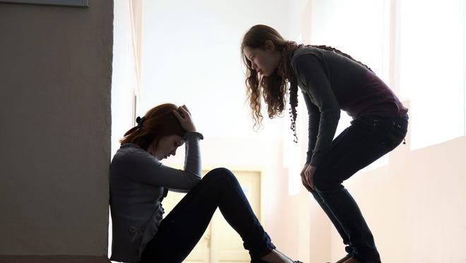 Teen girl offers to help her friend crying.