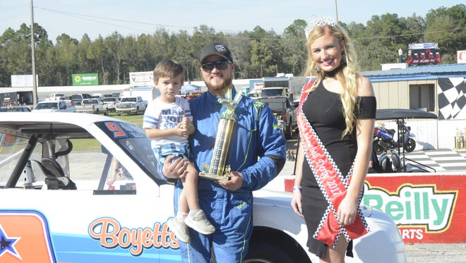 Logan Boyett holds his young son, LJ, after a race last season at Five Flags Speedway.