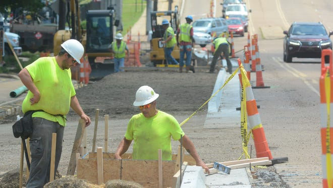 Hemphill Construction workers continue upgrades to Old Canton Road off of State Street in Fondren, including the installation of an inlet box for water flow on July 12, 2018.