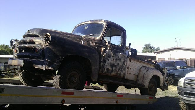 A photograph of the stolen truck recovered in this case.