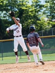 Centurians' Tommy Pellis jumps in the air to catch a ball and tag out Kyle Smith of Southern Fulton during a PIAA Class A baseball first-round game played at McConnellsburg on Monday, June 6, 2016. Southern Fulton defeated Greensburg Central Catholic 6-3.