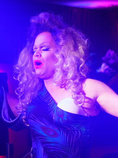 "Robert Hopwood, performing as Sandi Ego, lip sings to Adele's ""Set Fire to the Rain"" in his first drag performance at Copa Nightclub in Palm Springs, Calif., March 29, 2018."