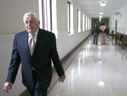 Stan Chesley walks the halls of the Hamilton County
