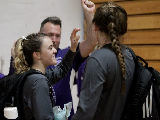 Shasta volleyball senior Sydney Montgomery (left) gets in the team's postgame huddle after Thursday's match against Red Bluff.