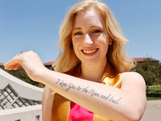 Kirsten Johnson shows the tattoo in honor of her late