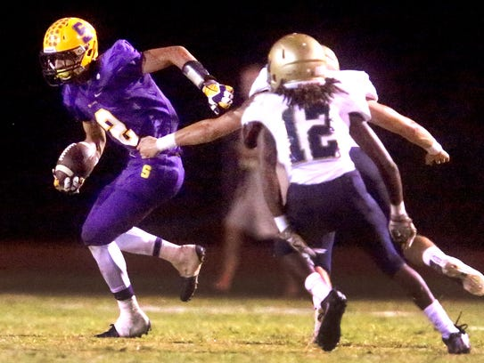 Smyrna's Percy Whittaker (2) runs the ball during the