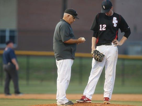 Stewarts Creek coach Mike Bartlett talks to pitcher
