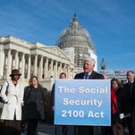 Rep. John B. Larson, D-Conn., accompanied by members of the House Ways & Means Committee, Social Security advocates, speaks during a news conference on Capitol Hill in Washington last month to announce the introduction of the Social Security 2100 Act. Molly Riley/AP