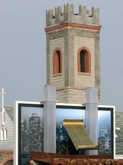 In this file photo from 2011, the Letterkenny Chapel is seen in the background, behind a replica of the World Trade Center twin towers that is being carried on a truck bed in the foreground.