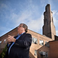 Children's home executive director Steve Bresnahan talks Thursday about damage to the tall tower at the facility caused by a lightning strike during a thunderstorm Wednesday night.