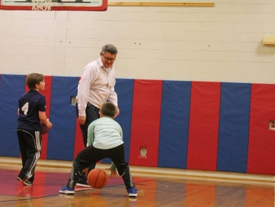 Brendan Tennant, vice principal playing basketball