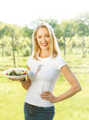 Stency Wegman at the Wegmans Organic Farm in Canandaigua, displaying the Next Door by Wegmans Blue Crab & Avocado Salad, inspired by her travels in Delray Beach, Florida.