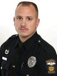 Mansfield Police Officer Brian Evans was shot and killed