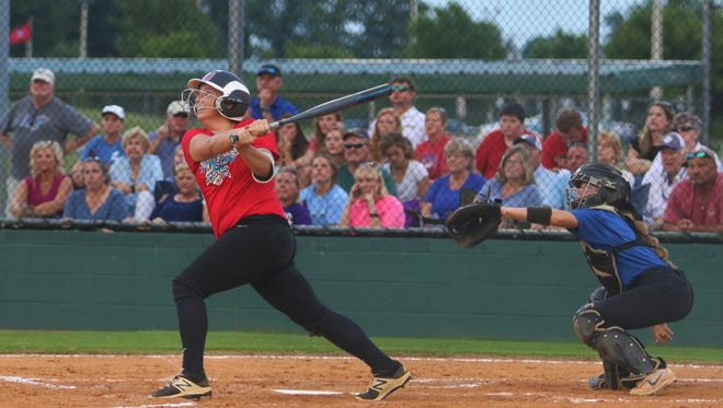 Lexington's Kaitlyn Kelley hits a home run in the Billy Schrivner Memorial High School Softball All-Star Classic at the West Tennessee Healthcare Sportsplex on May 31.