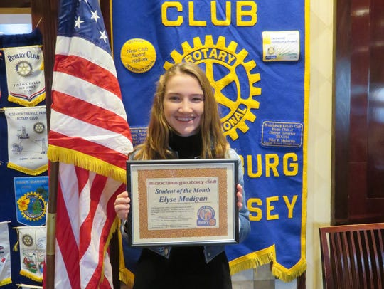 Elyse Madigan was awarded a Rotary Certificate, a gift