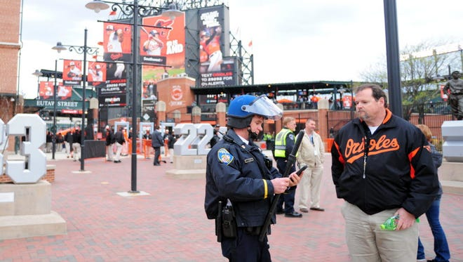 Police patrol outside Camden Yards in Baltimore, where on Wednesday the Orioles and White Sox will play in a game that will be closed to the public due to safety concerns over rioting.