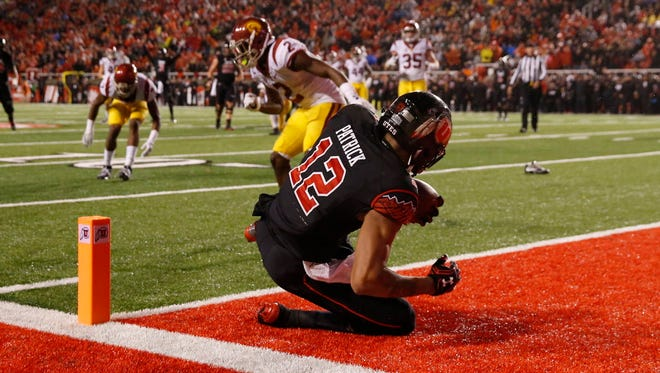 Utah wide receiver Tim Patrick (12) scores the game-winning touchdown against USC.