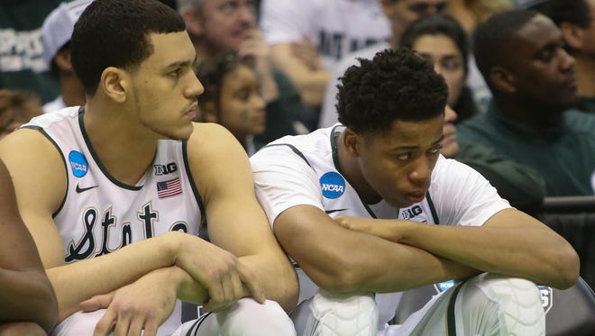 Gavin Schilling and Deyonta Davis sit dejected on the Michigan State bench during the final seconds of Friday's shocking loss to MTSU.