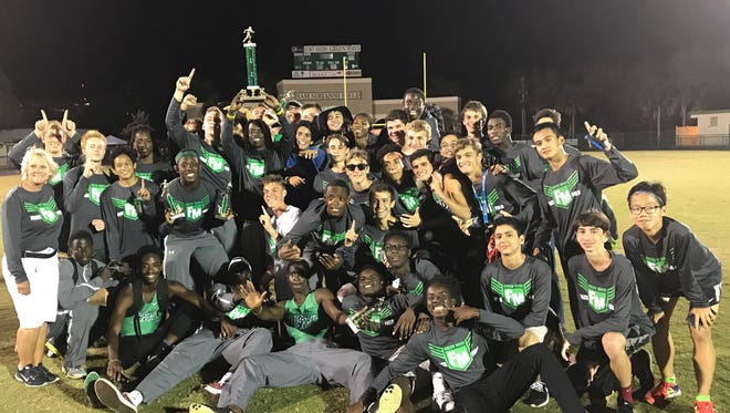 The Fort Myers boys track and field team celebrates its third straight Edison Relays title Friday at Edison Stadium.