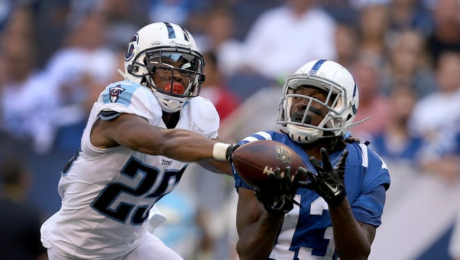 Tennesse Titans Blidi Wreh-Wilson,left, breaks up a pass intended for Indianapolis Colts T.Y. Hilton in the first half. The Indianapolis Colts played the Tennessee Titans Sunday. September 28, 2014, afternoon at Lucas Oil Stadium.
