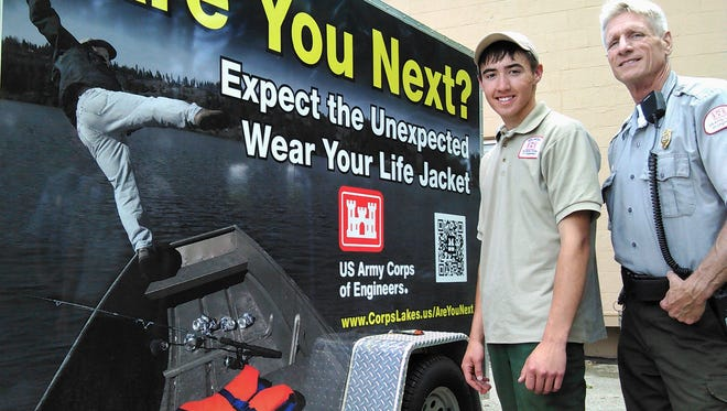 With the arrival of summer boating at Coralville Lake, the Corps of Engineers is promoting a simple concept often ignored – wear your life jacket.  This new water safety trailer sends a graphic message.  Shown with it are ranger Jeff Peck, right, and summer intern Hunter Gehrke.