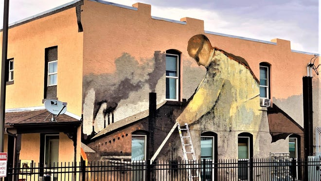 "Dubbed ""The Steel Worker"" by creator Dan Levinson, this huge mural now graces the building at 1228 E. Evans Ave."