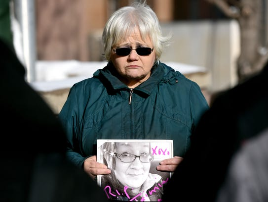 Judy Silk holds a picture of her sister-in-law, Jamie