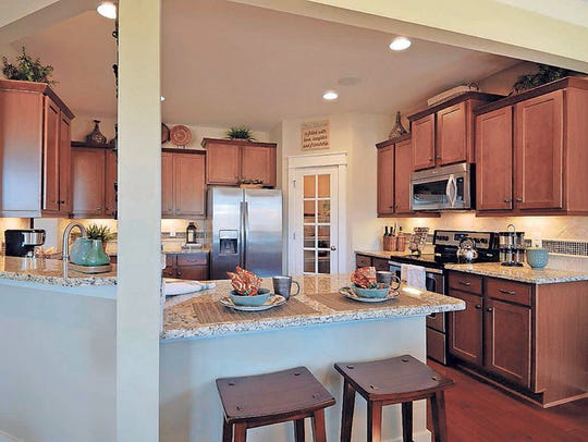 The Russell II cottage model boasts a spacious kitchen.