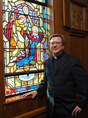 The Rev. Andrew Carrozza in the chapel at St. Anne's Catholic Parish in Yonkers.