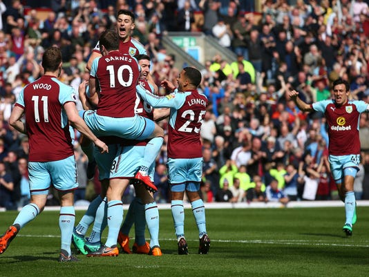 Burnley's Kevin Long, center, is mobbed by team mates after scoring his side's second goal of the game during the English Premier League soccer match between Burnley and Leicester City at Turf Moor stadium, Burnley, England. Saturday, April 14, 2018, 2018. (Dave Thompson/PA via AP)