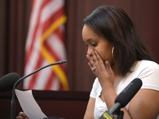Jeanitia Harris wipes tears while reading her statement during the sentencing of Stephanie Ferguson.