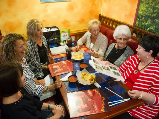 Holly Bertram, clockwise from lower left, Mindy McDurmon, Elizabeth Reeves, and their mothers, Brenda Willner, Mary Simon and Carol Hunter, all of Evansville, gather for a birthday dinner at Los Bravos Monday. Willner, Simon and Hunter shared a room in the hospital and became friends after their children were born 50 years ago.