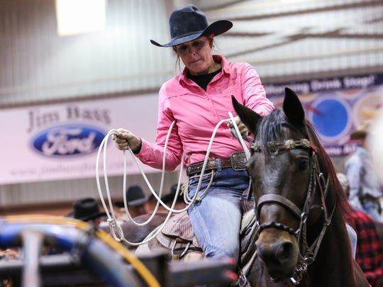 Donelle Kvenild gets ready to ride during the 64th annual Roping Fiesta Sunday, Oct. 29, 2017, in the 1st Community Credit Union Spur Arena.