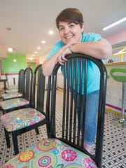 Co-owner Amber Leek shows off her new brightly patterned